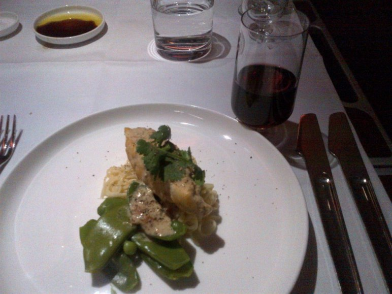 Sanpper poached in coconut milk and garam masala with fine eggg noodles and snow peas