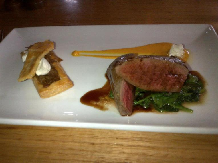 Seared Margaret River venison with onion tart, carrot puree, whipped goats' cheese and blackberry jus