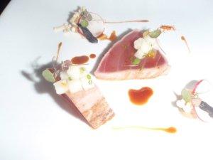 Yellow fin tuna tartar, white radish, yuzu, black garlic