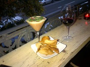 Nacho's cheese fondue with a glass of sangiovese merlot